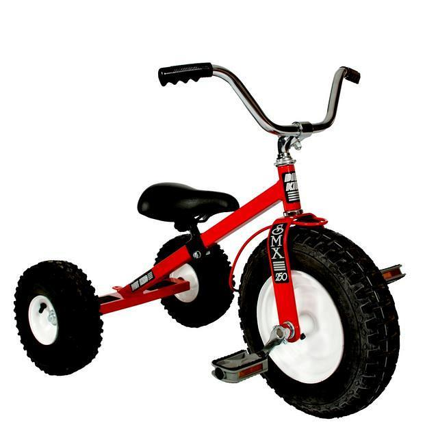 Red childrens tricycle.